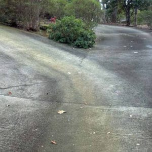 Driveway Before Our Pressure Washing Service Surface Clean.