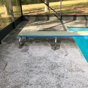 Pool side and diving board Before Our Pressure Washing Service Surface Clean