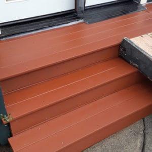 Wood deck back door after pressure washed