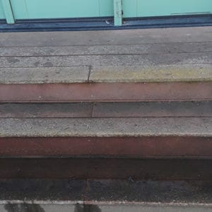 Wood deck back door before pressure washed