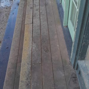 Wood deck opposite view before pressure washed