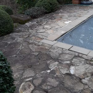 Pool side stone before pressure washer
