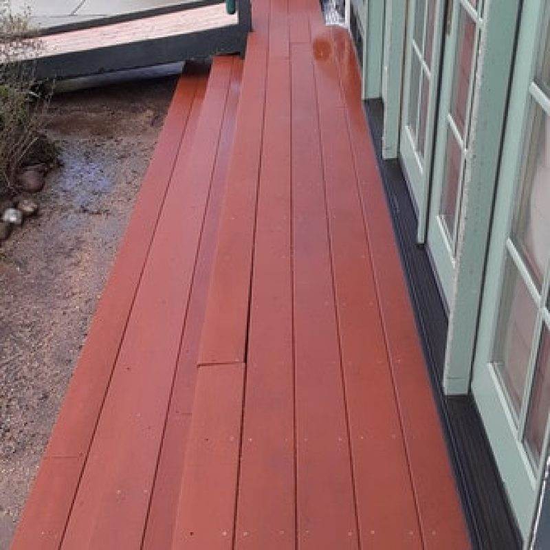 Wood deck opposite view after pressure washed