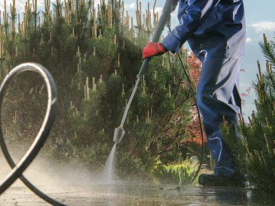Garden Paths Power Washing Using Pressure Washer. Backyard Maintenance.