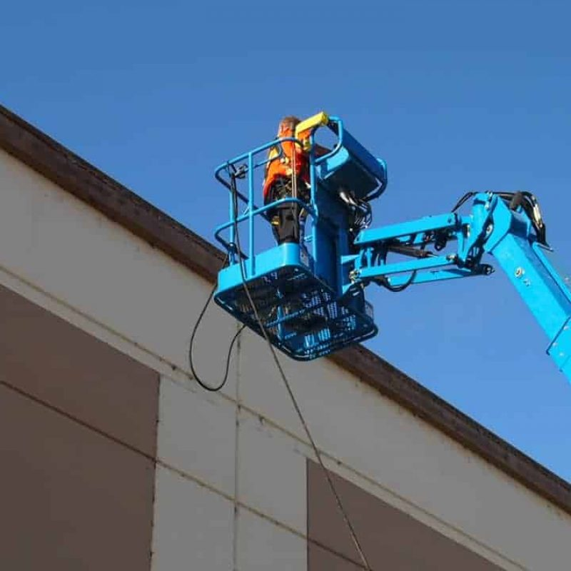 Preparing to pressure wash a retail building in Napa